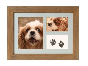 Tribute Frame Maxi in Oak showing paw-print and photos