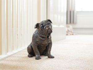 Cast resin urn in the shape of an english bulldog dog
