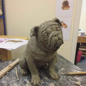 Bulldog urn in sitting position being sculpted